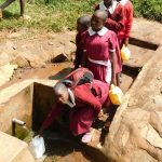 The Water Project: Ebukhuliti Primary School -  Fetching Water