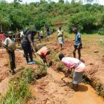 The Water Project: Mutao Community, Kenya Spring -  Opening The Drainage Channel