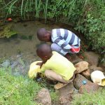 The Water Project: Kalenda B Community, Lumbasi Spring -  Children Fetch Water