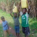 The Water Project: Mukangu Community, Metah Spring -  Children Carrying Water