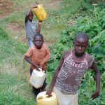 The Water Project: Kimarani Community, Kipsiro Spring -  Carrying Water Home