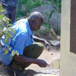 The Water Project: Kapchorwa Primary School -  Painting Latrine Walls