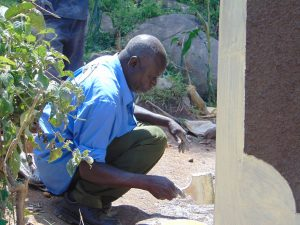 The Water Project:  Painting Latrine Walls