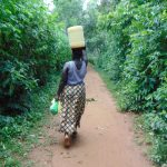 The Water Project: Munenga Community, Francis Were Spring -  Carrying Water Home