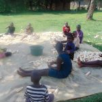 The Water Project: Mukangu Community, Metah Spring -  Children Shelling Maize