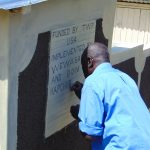 The Water Project: Kapchorwa Primary School -  Inscribing Latrine Plaque