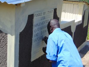 The Water Project:  Inscribing Latrine Plaque