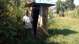 The Water Project:  Woman With Latrine
