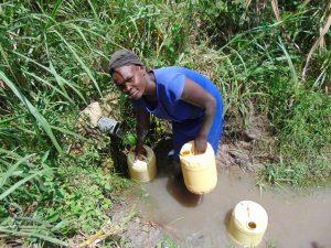 The Water Project:  Sarah Lumumba Fills Up