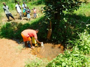 The Water Project:  People Wait To Fetch Water
