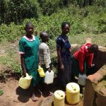 The Water Project: Mwichina Primary School -  Students Line Up To Fetch Water