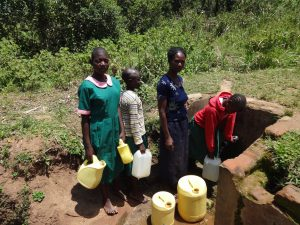 The Water Project:  Students Line Up To Fetch Water