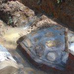 The Water Project: Shamiloli Community, Kwasasala Spring -  Rub Wall Under Construction