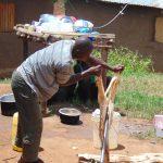 The Water Project: Kimaran Community, Kipsiro Spring -  Spring Landowner Mark Kipsiro Splits Wood