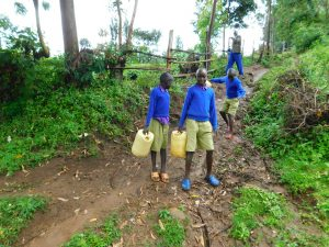 The Water Project:  Sliding On Muddy Road To The Spring