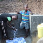 The Water Project: Eshikhugula Community, Shaban Opuka Spring -  Flowing Water