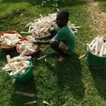 The Water Project: Emurumba Community, Makokha Spring -  Child With Maize Cobs