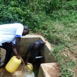 The Water Project: Maganyi Community, Bebei Spring -  Filling Up