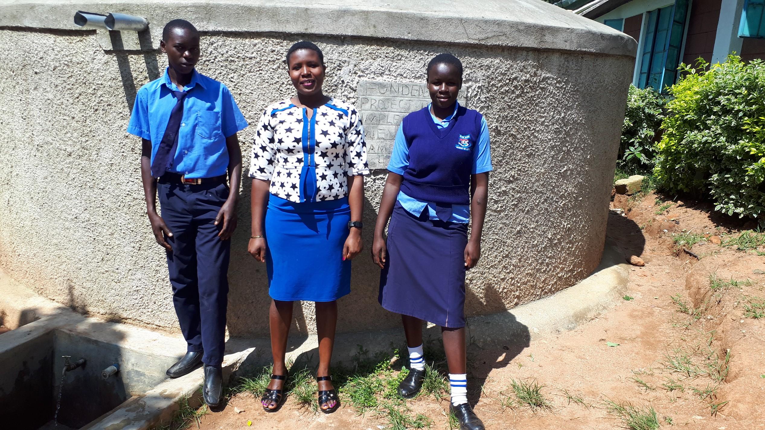 The Water Project : 2-kenya18014-posing-at-the-tank