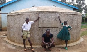 The Water Project:  Stuents With Field Officer Samuel