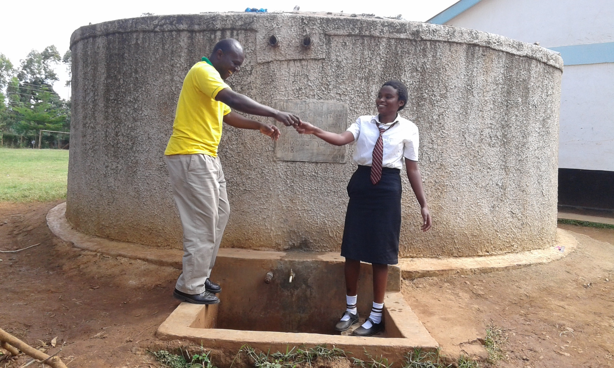 The Water Project : 2-kenya18028-deputy-head-teacher-jason-asenga-with-student
