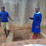 The Water Project: Shina Primary School -  Students At Rain Tank
