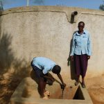 The Water Project: Kenneth Marende Primary School -  Dickson Turns On The Tap Next To Teacher Mrs Sarah Oyiera Okech