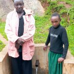 The Water Project: Chandolo Community, Joseph Ingara Spring -  Joseph Ingara With Stacy Vugutsa