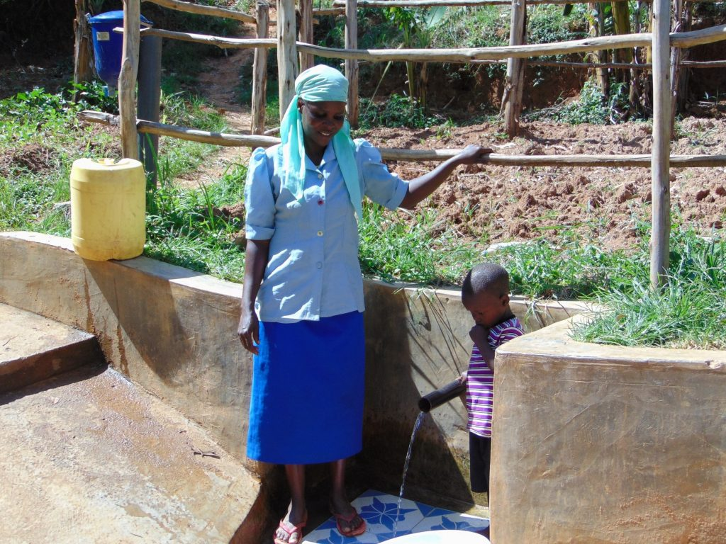 The Water Project : 2-kenya18095-eunice-shibale-with-justin-mbone