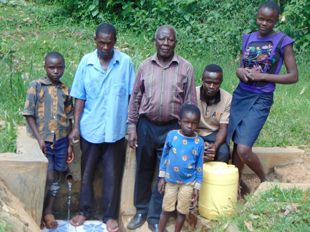 The Water Project : 2-kenya18096-community-members-at-the-spring