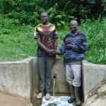 The Water Project: Ulagai Community, Aduda Spring -  William Okello Left And John Madara Right