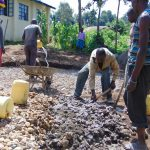 The Water Project: Kapchorwa Primary School -  Mixing Stones Into Cement For Tank Foundation