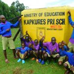 The Water Project: Kapkures Primary School -  Boys With School Motto