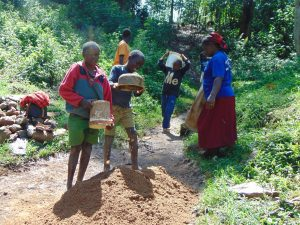 The Water Project:  Children Deliver Sand For Construction