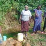 The Water Project: Mukangu Community, Metah Spring -  Community Members At The Spring