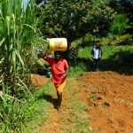 The Water Project: Ewamakhumbi Community, Mukungu Spring -  Carrying Water Home