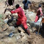 The Water Project: Shamiloli Community, Kwasasala Spring -  Backfilling The Spring With Stones