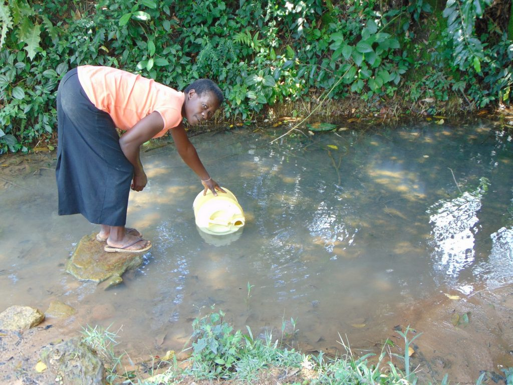The Water Project : 21-kenya19157-carolyne-makhavali-fetches-water