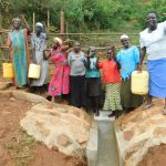 The Water Project: Mutao Community, Kenya Spring -  Cheering Women At The Spring