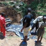The Water Project: Shamiloli Community, Kwasasala Spring -  Backfilling With Plastic Tarp