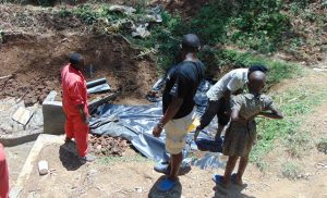 The Water Project:  Backfilling With Plastic Tarp