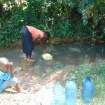 The Water Project: Bukhaywa Community, Ashikhanga Spring -  Waiting While Filling Up