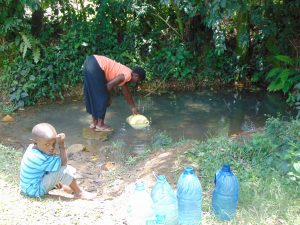 The Water Project:  Waiting While Filling Up