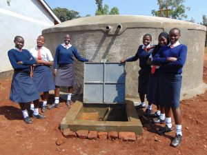 The Water Project:  Girls With Finished Tank