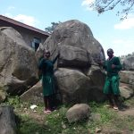 The Water Project: Mwichina Primary School -  Students Pose By The Rocks