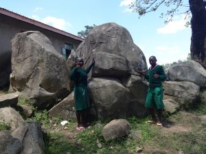 The Water Project:  Students Pose By The Rocks
