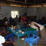 The Water Project: Buhayi Community, Nasichundukha Spring -  Community Members And Field Officers Share A Meal As Thanks