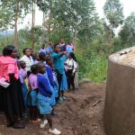 The Water Project: Kapchorwa Primary School -  Explaining Tank Maintenance
