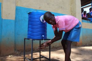 The Water Project:  Student Washes His Hands