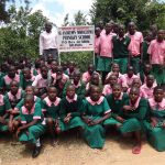The Water Project: Mwichina Primary School -  Students Pose With School Sign